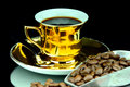 Coffe cup isolated old gold and beans Stock Photo