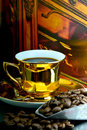 Coffe cup and old background gold beans Royalty Free Stock Image