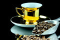 Coffe cup old gold and beans Royalty Free Stock Photo