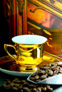 Coffe cup old gold and beans Royalty Free Stock Images