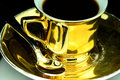 Coffe cup old gold and beans Stock Image
