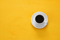 coffe cup on wooden yellow background Royalty Free Stock Photo