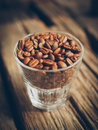 Coffee bean on the cups vintage color tone in Royalty Free Stock Image