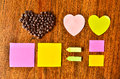 Coffee bean with heart shape and colorful stick note