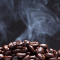 Coffee bean with smoke Royalty Free Stock Photo
