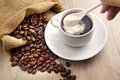 Coffee bean and a spoon milk powder Royalty Free Stock Photo