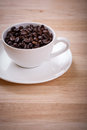 Coffee bean in white cup a lot of Stock Photography