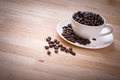 Coffee bean in white cup a lot of Royalty Free Stock Photo