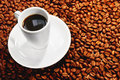 Coffee on Beans Royalty Free Stock Photos