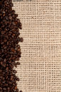 Coffee Beans and background burlap Royalty Free Stock Image