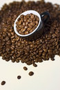 Coffee beans in the  black cup. Close up Stock Photography