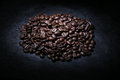 Coffee beans on a black slate Stock Photos