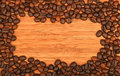 Coffee beans border frame over bamboo wood background Royalty Free Stock Photo