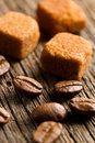 Coffee beans with brown sugar cubes Stock Photo