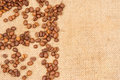 Coffee beans on burlap background Stock Image