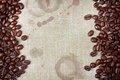 Coffee beans and burlap with coffee stains rough edges Stock Photos