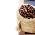 Coffee beans in burlap sack over white Stock Photography