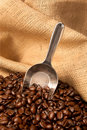 Coffee beans in burlap sack with scoop Stock Photo