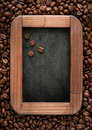 Coffee beans on the chalkboard menu chalk board with in a vintage style Royalty Free Stock Photography