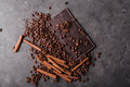 Coffee beans with chocolate dark chocolate. Broken slices of chocolate. Chocolate bar pieces. Royalty Free Stock Photo