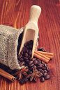 Coffee beans cinnamon and anise with spoon on wooden table Royalty Free Stock Images