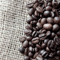 Coffee beans on cloth sack close up of Royalty Free Stock Photos