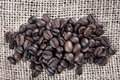 Coffee beans on cloth sack close up of Royalty Free Stock Images