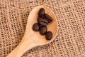 Coffee beans coffee beans close up in wodden spoon Royalty Free Stock Photography
