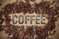 Coffee beans coffee inscription canvas Royalty Free Stock Photo