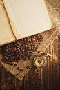 Coffee beans and compass Royalty Free Stock Photo