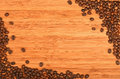 Coffee beans corners over bamboo wood background Royalty Free Stock Photo