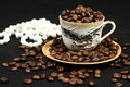 Coffee beans in a cup and beads Royalty Free Stock Photo
