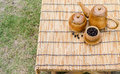 Coffee beans, cup of coffee and teapot on bamboo wooden desk. Royalty Free Stock Photo