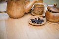 Coffee beans, cup of coffee and teapot on wooden desk. Royalty Free Stock Photo