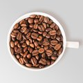 Coffee beans cup of fresh on table view from above Stock Images