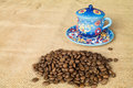 Coffee beans and cup pile of colored in background Royalty Free Stock Photos