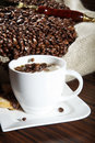 Coffee beans with cup and sack Royalty Free Stock Photo