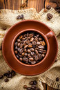 Coffee beans in a cup on a wooden table Royalty Free Stock Photography