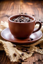 Coffee beans in a cup on a wooden table Stock Photography