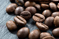 Coffee beans on a dark background selective focus close up horizontal Royalty Free Stock Photography