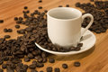 Coffee Beans with Demitasse Espresso Cup Stock Images
