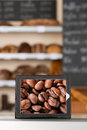 Coffee beans displayed in digital tablet at coffee shop closeup of Royalty Free Stock Photos