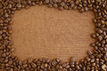 Coffee beans frame on grunge wooden board background Stock Photos