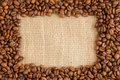 Coffee beans frame on hessian background Stock Photo