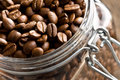 Coffee beans in glass jar Royalty Free Stock Image