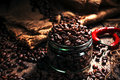 Coffee beans in a glass jar, black background Royalty Free Stock Photo