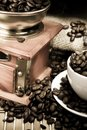 Coffee, beans and grinder on sacking in night time Stock Photography