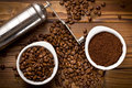 Coffee beans with ground coffee and grinder top view of Stock Image