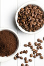 Coffee beans and ground coffee top view of in bowls Stock Images