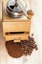 Coffee beans and ground lying side by side on the old board Royalty Free Stock Photos